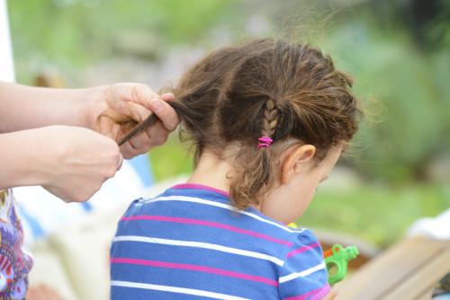 iStock_000041150624XLarge_Girl_braiding_hair